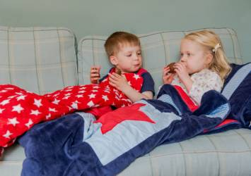 toddlers on sofa